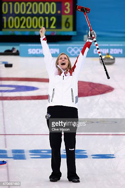 Jennifer Jones of Canada celebrates after placing a stone to win the gold medal looks on during the Gold medal match between Sweden and Canada on day...