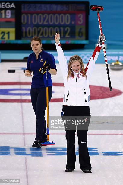 Jennifer Jones of Canada celebrates after placing a stone to win the gold medal while Maria Wennerstroem of Sweden looks on during the Gold medal...
