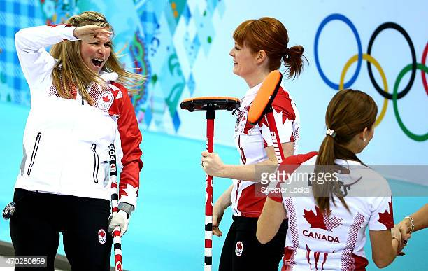 Jennifer Jones of Canada celebrates with teammate Dawn McEwen after defeating Great Britain during the women's curling semifinals at Ice Cube Curling...