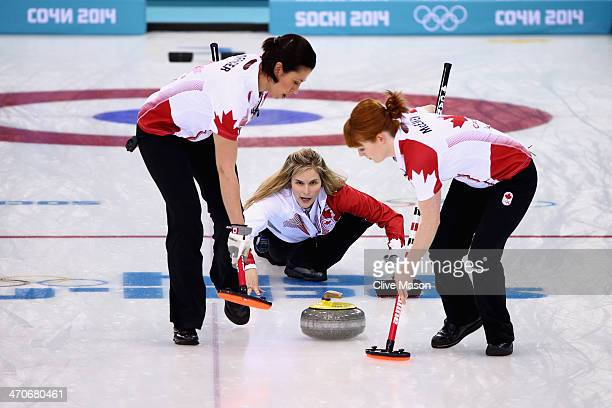 Jennifer Jones of Canada places a stone while Jill Officer and Dawn McEwen of Canada swepduring the Gold medal match between Sweden and Canada on day...