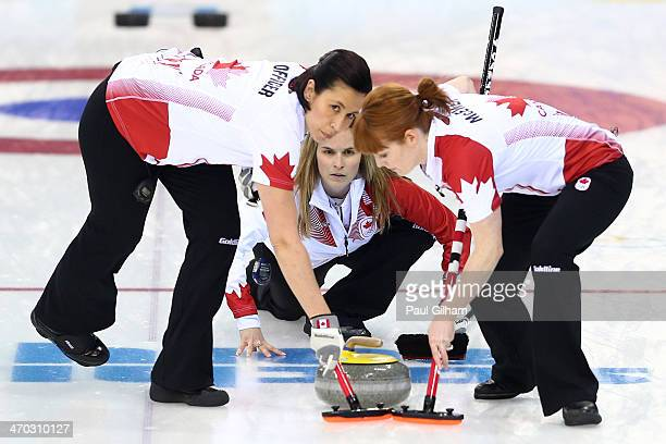 Jennifer Jones of Canada releases the stone during the women's semifinal match between Great Britain and Canada at Ice Cube Curling Center on...