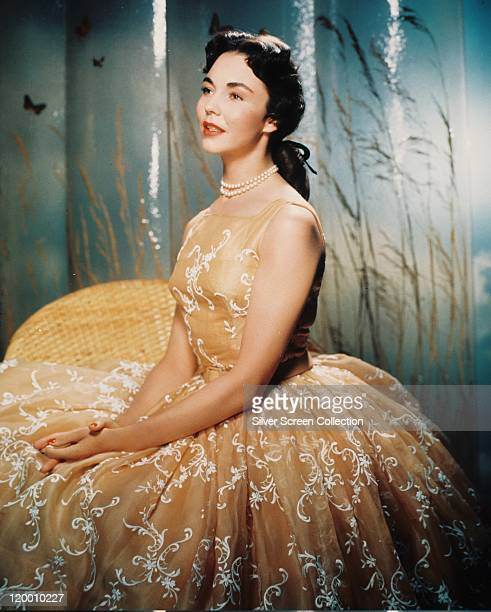 Jennifer Jones US actress wearing a silk ballgown with white motifs and a pearl necklace in a studio portrait circa 1945