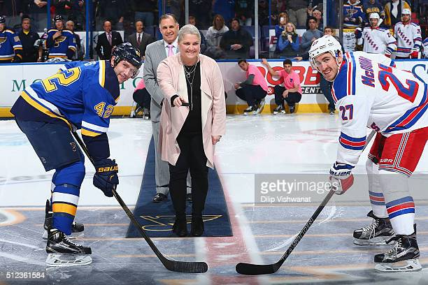 Jennifer Kelly wife of St Louis Blues radio announcer John Kelly and a breast cancer survivor drops the puck for David Backes the St Louis Blues and...