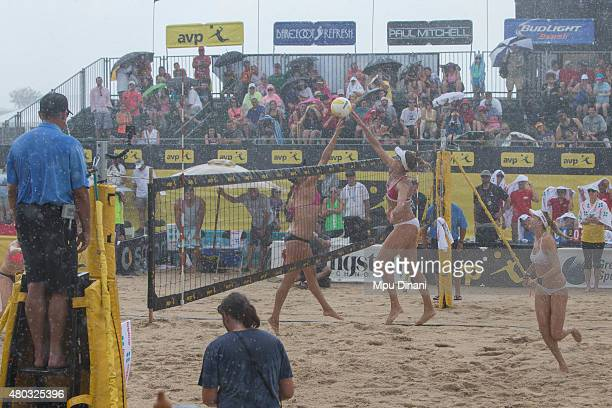 Jennifer Kessy and April Ross joust at the net while Kerri WalshJennings looks on during a downpour at the AVP New Orleans Open at Laketown on May 24...