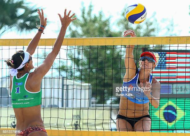 Jennifer Kessy of USA jumps up to spike the Mikasa over Fernanda Alves of Brazil during the 4th day of the FIVB Antalya Open part of the FIVB Beach...