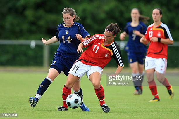 Jennifer King of Scotland and Jessica Wich of Germany battle for the ball during the Women's U19 European Championship match between Scotland and...
