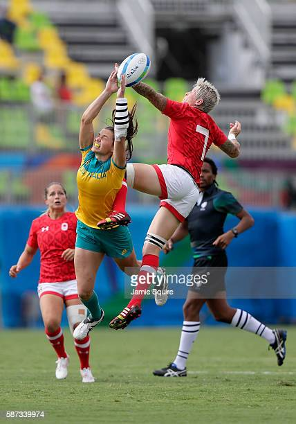 Jennifer Kish of Canada and Chloe Dalton of Australia goe up for the ball during the Women's Semi Final 1 Rugby Sevens match between Australia and...