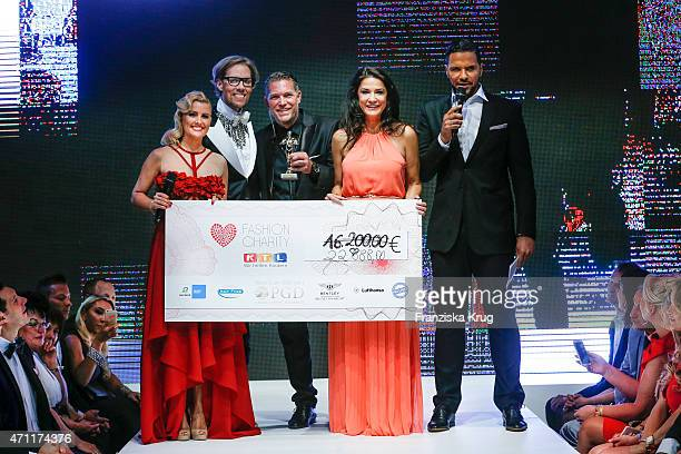 Jennifer Knaeble Jens Hilbert Mariella Ahrens and Kena Amoa attend the Fashion Charity Event 2015 in favor of the 'RTL Wir helfen Kindern' foundation...