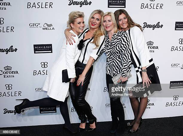 Jennifer Knaeble, Magdalena Brzeska, Aleksandra Bechtel and Sandra Thier attend the Basler fashion show on February 1, 2014 in Dusseldorf, Germany.