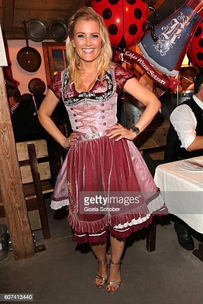 Jennifer Knaeble wearing a dirndl by Lola Paltinger during the opening of the Oktoberfest 2016 at the 'Kaeferschaenke' beer tent at Theresienwiese on...