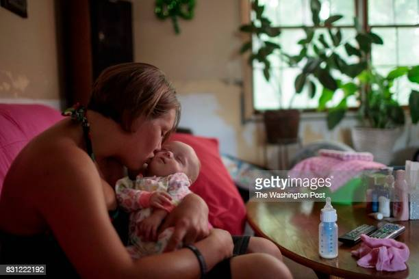 Jennifer Kostoff kisses her 4monthold daughter Rikki at her Granite City Illinois home on July 26 2017 Kostoff became pregnant when she relapsed...