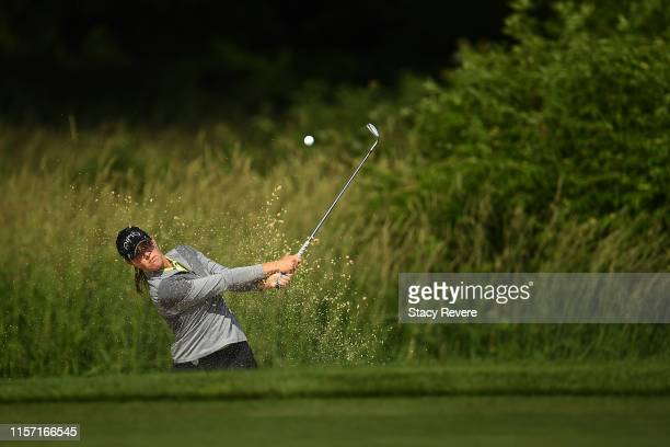 Jennifer Kupcho hits from a green side bunker on the 10th hole during the first round of the KPMG PGA Championship at Hazeltine National Golf Club on...