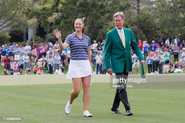 Jennifer Kupcho of the United States and Chairman of Augusta National Golf Club and the Masters Tournament Fred Ridley walk to the trophy ceremony...