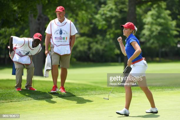 Jennifer Kupcho of the United States celebrates after a birdie putt on the ninth green during fourball matches on day one of the 2018 Curtis Cup at...