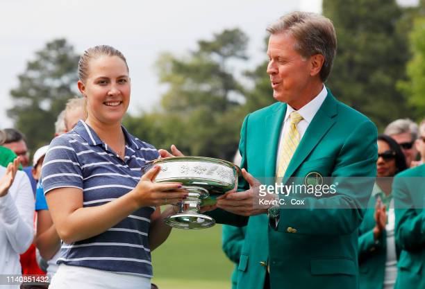 Jennifer Kupcho of the United States celebrates with Chairman of Augusta National Golf Club and the Masters Tournament Fred Ridley and the trophy...