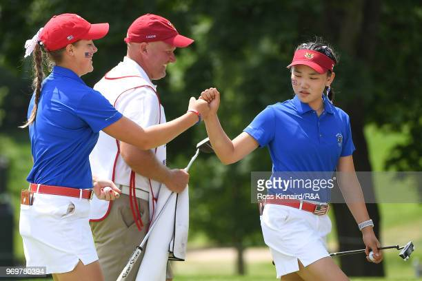 Jennifer Kupcho of the United States celebrates with Lucy Li after a putt on the ninth green during fourball matches on day one of the 2018 Curtis...