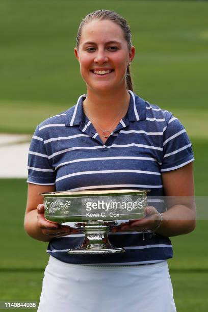 Jennifer Kupcho of the United States celebrates with the trophy after winning the Augusta National Women's Amateur at Augusta National Golf Club on...