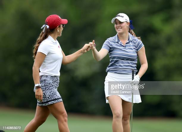 Jennifer Kupcho of the United States is congratulated by her playing partner Maria Fassi of Mexico after playing her tee shot on the par 3 12th hole...