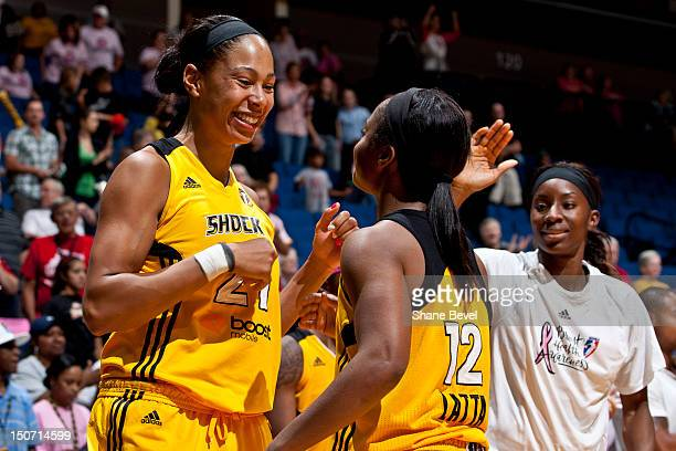 Jennifer Lacy Ivory Latta and Scholanda Dorrell of the Tulsa Shock celebrate their victory during the WNBA game on August 24 2012 at the BOK Center...