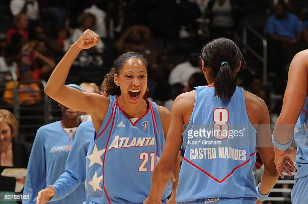 Jennifer Lacy of the Atlanta Dream celebrates on the court during a time out against the Los Angeles Sparks on September 11, 2008 at Staples Center...