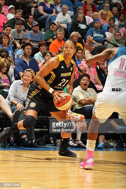 Jennifer Lacy of the Tulsa Shock looks to dribble against Candice Wiggins of the Minnesota Lynx during the WNBA game on August 19 2012 at Target...