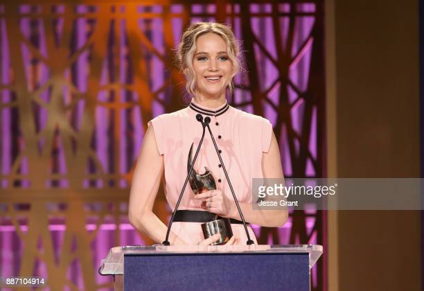 Jennifer Lawrence accepts award onstage at The Hollywood Reporter's 2017 Women In Entertainment Breakfast at Milk Studios on December 6 2017 in Los...