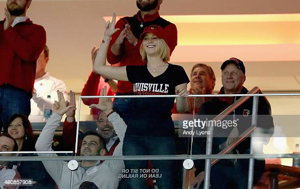 Jennifer Lawrence acknowledges the crowd during the Kentucky Wildcats game against the Louisville Cardinals at KFC YUM Center on December 27 2014 in...