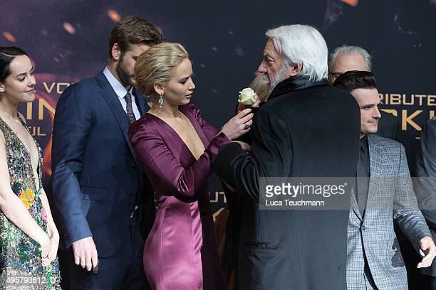 Jennifer Lawrence and Donald Sutherland attend the world premiere of the film 'The Hunger Games Mockingjay Part 2' at CineStar on November 4 2015 in...
