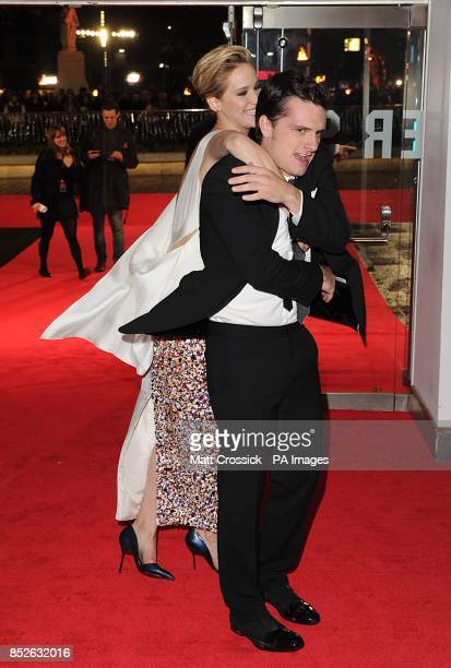 Jennifer Lawrence and Josh Hutcherson arriving for the World Premiere of The Hunger Games Catching Fire at the Odeon Leicester Square London