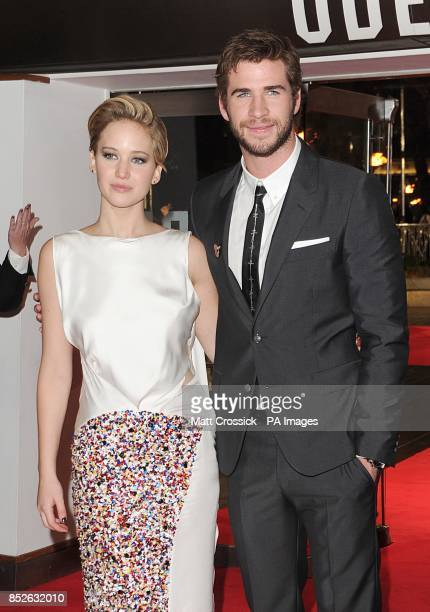 Jennifer Lawrence and Liam Hemsworth arriving for the World Premiere of The Hunger Games Catching Fire at the Odeon Leicester Square London