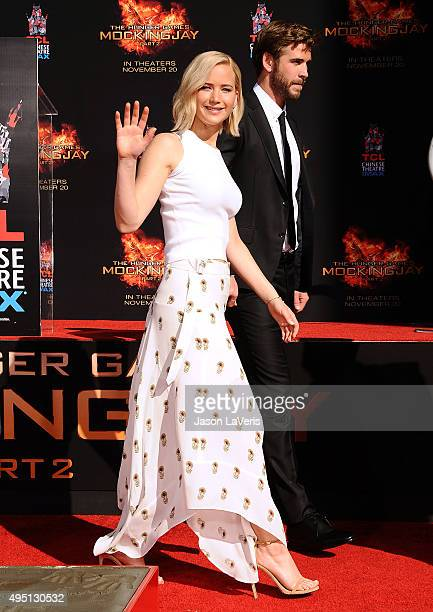 """Jennifer Lawrence and Liam Hemsworth attend """"The Hunger Games: Mockingjay - Part 2"""" hand and footprint ceremony at TCL Chinese Theatre on October 31,..."""