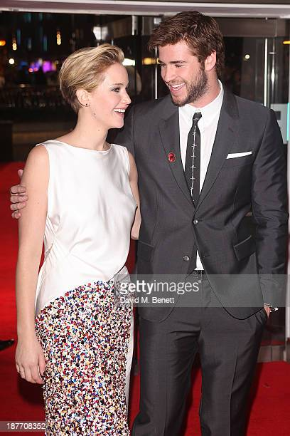 Jennifer Lawrence and Liam Hemsworth attend the UK Premiere of The Hunger Games Catching Fire at Odeon Leicester Square on November 11 2013 in London...