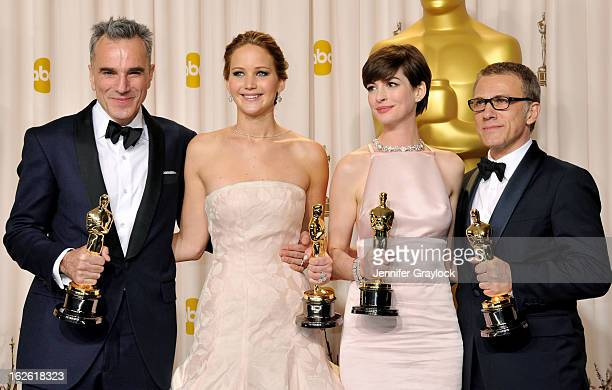 Jennifer Lawrence Anne Hathaway Daniel DayLewis and Christoph Waltz in the press room during the 85th Annual Academy Awards held at the Loews...