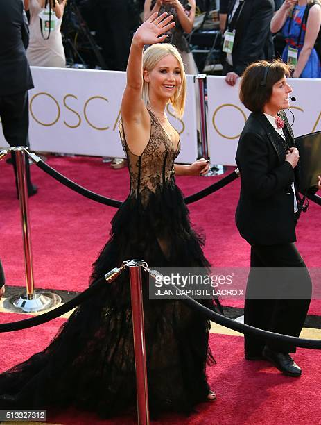 Jennifer Lawrence arrives on the red carpet for the 88th Oscars on February 28 2016 in Hollywood California AFP / JEAN BAPTISTE LACROIX / AFP / JEAN...