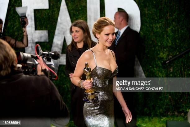 Jennifer Lawrence carrying her Oscar for best actress arrives for the 2013 Vanity Fair Oscar Party on February 24 2013 in Hollywood California AFP...