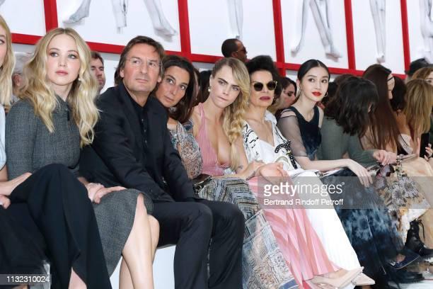 Jennifer Lawrence CEO of Dior Pietro Beccari his wife Elisabetta Beccari Cara Delevingne Bianca Jagger and Angelababyattend the Christian Dior show...