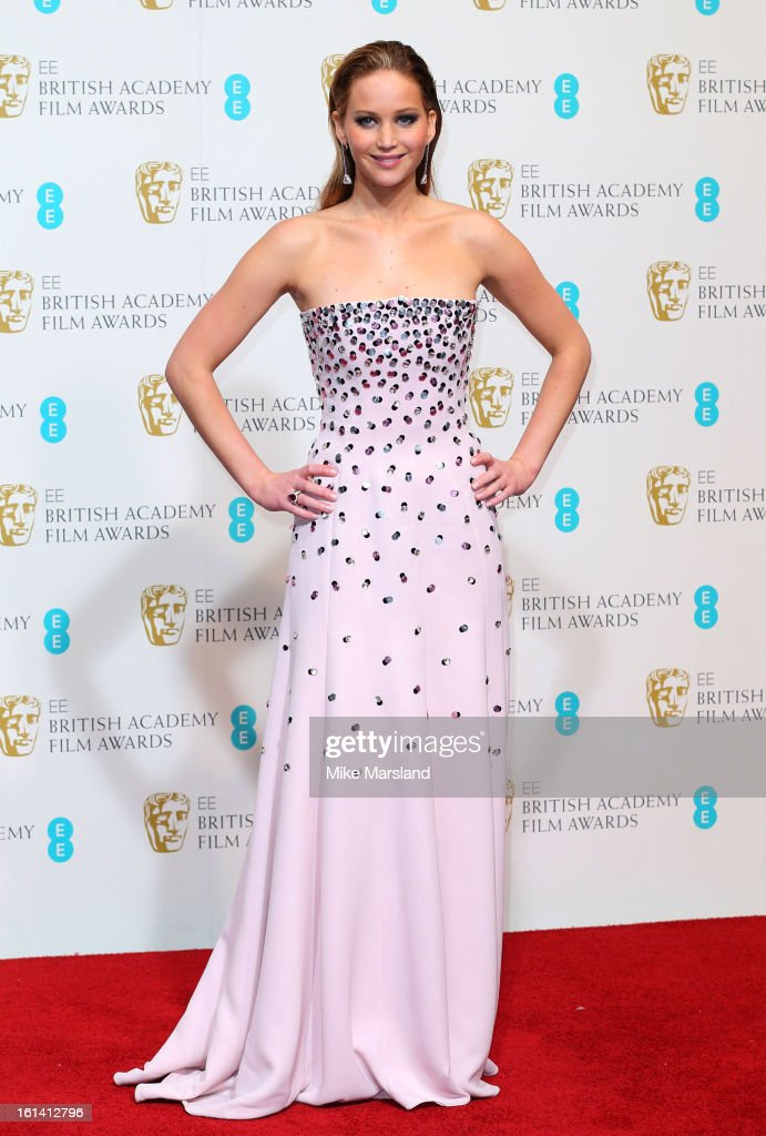 Jennifer Lawrence poses in the Press Room at the EE British Academy Film Awards at The Royal Opera House on February 10, 2013 in London, England.