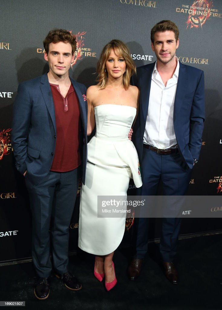 Jennifer Lawrence, Sam Claflin and Liam Hemsworth attend a party for 'The Hunger Games: Catching Fire' at The 66th Annual Cannes Film Festival at Baoli Beach on May 18, 2013 in Cannes, France.
