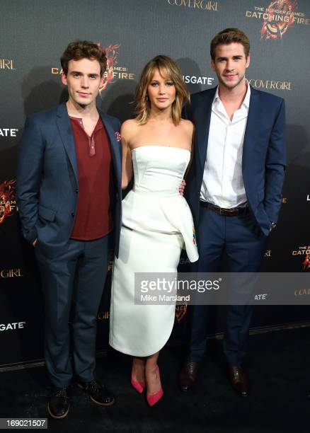 Jennifer Lawrence Sam Claflin and Liam Hemsworth attend a party for 'The Hunger Games Catching Fire' at The 66th Annual Cannes Film Festival at Baoli...