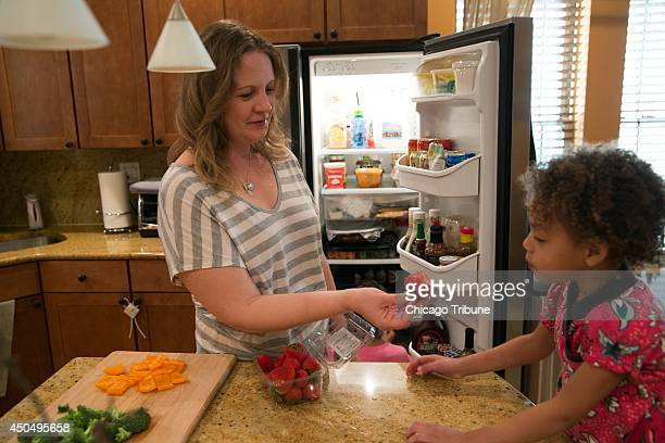 Jennifer Leigh with her daughter Janelle at home in Evanston Ill has lost her sense of smell and has adapted to daily tasks such as cooking by...