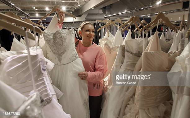 Bella sera bridal stock photos and pictures getty images jennifer lemoine of reading looks through racks of gowns during the north shores own version of junglespirit Gallery
