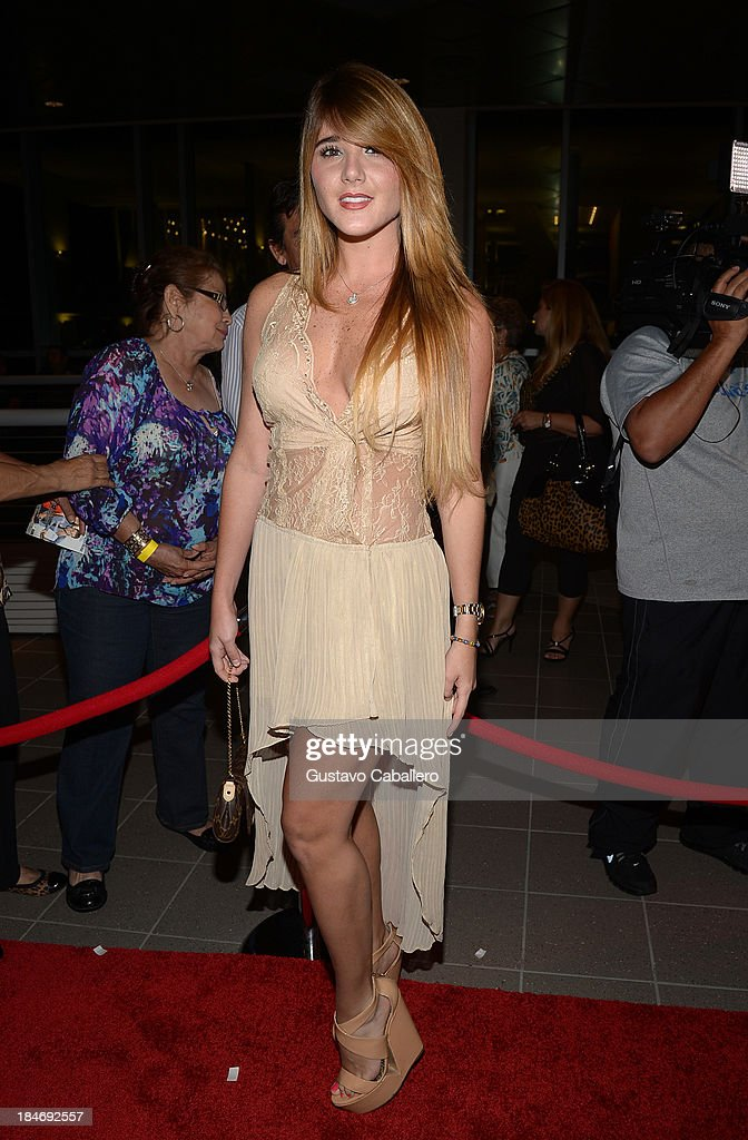 Jennifer Lemus arrives for the premiere of 'The Snitch Cartel' at Regal South Beach on October 14, 2013 in Miami, Florida.