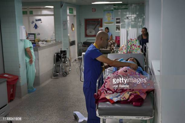 Jennifer Leonardy, originally from Venezuela, is helped by a doctor in the maternity ward of the University Hospital Erasmo Meoz on March 1, 2019 in...