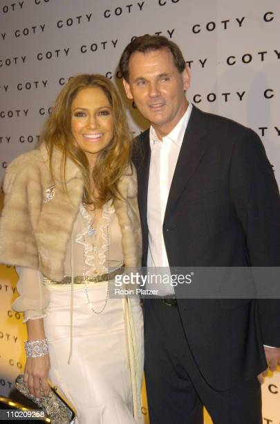 Jennifer Lopez and Bernd Beetz CEO of Coty during The 100th Anniversary of Coty at American Museum of Natural Historys Rose Center for Earth in New...