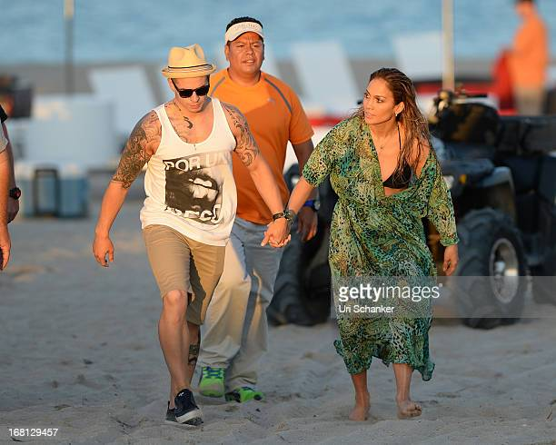 Jennifer Lopez and Casper Smart are sighted after gun shots are fired as they film a commercial on the beach on May 5 2013 in Fort Lauderdale Florida
