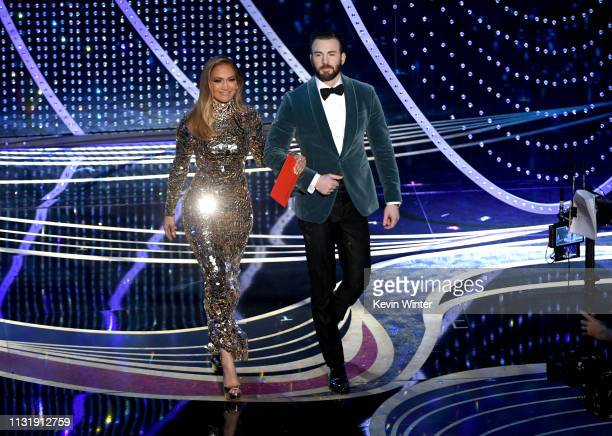 Jennifer Lopez and Chris Evans walk onstage during the 91st Annual Academy Awards at Dolby Theatre on February 24 2019 in Hollywood California