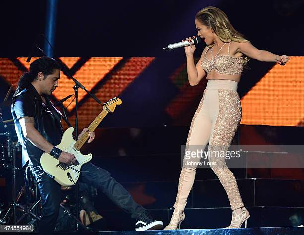 Jennifer Lopez and Chris Perez performs musical tribute to Selena while performing with Los Dinos onstage at the 2015 Billboard Latin Music Awards...