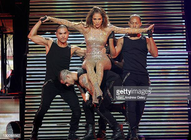 Jennifer Lopez and dancer Casper Smart perform onstage during a Special Concert at Mohegan Sun's 15th Anniversary Celebration on October 22 2011 in...