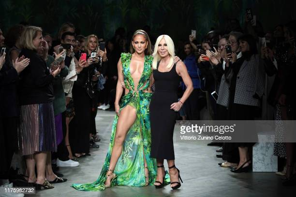 Jennifer Lopez and Donatella Versace walk the runway at the Versace show during the Milan Fashion Week Spring/Summer 2020 on September 20, 2019 in...