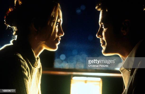 Jennifer Lopez and George Clooney looking romantically at each other in a scene from the film 'Out Of Sight' 1998